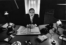 Roger-Viollet | 1376112 | Bruno Coquatrix (1910-1979), French composer, impresario and director of the Paris Olympia, at his desk. Paris (IXth arrondissement), 12 October 1970. Photograph by André Perlstein (born in 1942). | © André Perlstein / Roger-Viollet