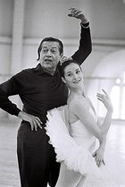 Roger-Viollet | 1376286 | Serge Lifar (1905-1986), Russian-born French dancer and choreographer, rehearsing with Noëlla Pontois (born in 1943), lead dancer of the Paris Opera, at the Opéra Garnier. Paris (IXth arrondissement), 30 March 1977. Photograph by André Perlstein (born in 1946). | © André Perlstein / Roger-Viollet