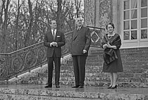 Roger-Viollet | 1380094 | Prince Philip, Duke of Edinburgh (1921-2021), at the Trianon with Charles de Gaulle (1890-1970), President of the French Republic, and his wife Yvonne de Gaulle (1900-1979). Palace of Versailles (France), on December 20, 1966. Photograph by Bernard Charlet, from the collections of the French newspaper  France-Soir . Bibliothèque historique de la Ville de Paris. | © Pansu, Michel / Bernard Charlet / Roger-Viollet